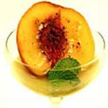 Caramelized Peaches with Mango Coulis.