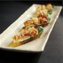 Roast Maine Lobster on a Garlic and White Bean Burschetta.