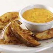 Roasted Potato Wedges with Cheddar Sauce.