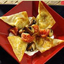 Three-Cheese and Artichoke Potstickers with Roasted Tomato Salad.