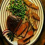 Broiled Steaks with Herb-Cheese Potatoes recipe