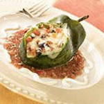 Chiles Rellenos with Cheese, Dried Apricots, Pecans and Guajillo Chile Sauce recipe