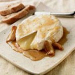 Honey and Roasted Garlic-Baked Brie with Baguettes recipe