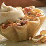 Apple-Raisin Tartlets with Cheddar and Calvados Sour Cream recipe